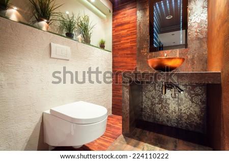 Horizontal view of interior of modern bathroom - stock photo