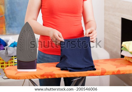 Horizontal view of ironing clothes at home - stock photo