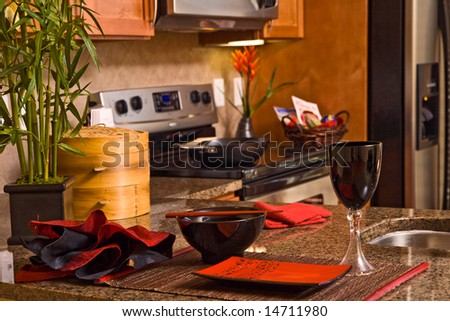 Horizontal view of kitchen bar with orential table place sitting, - stock photo