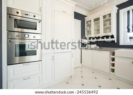 Horizontal view of kitchen interior with modern furniture - stock photo