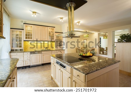 Horizontal view of kitchen with marble worktop - stock photo