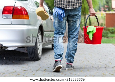 Horizontal view of male car wash worker - stock photo