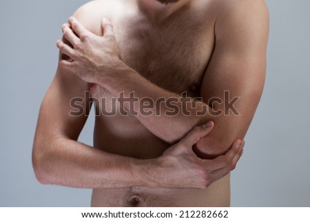 Horizontal view of man with hurting elbow