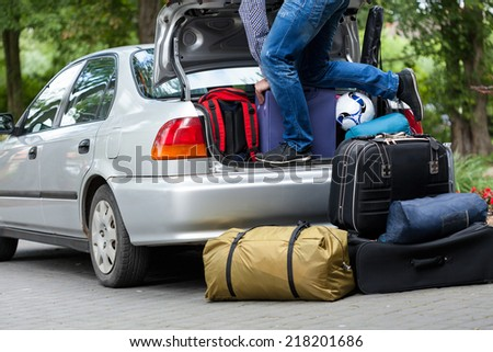Horizontal view of preparation for long family trip - stock photo