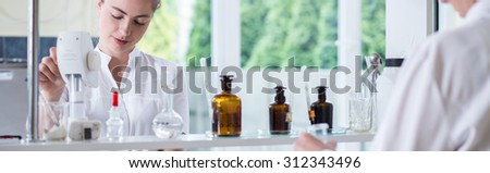 Horizontal view of students having chemistry lesson - stock photo