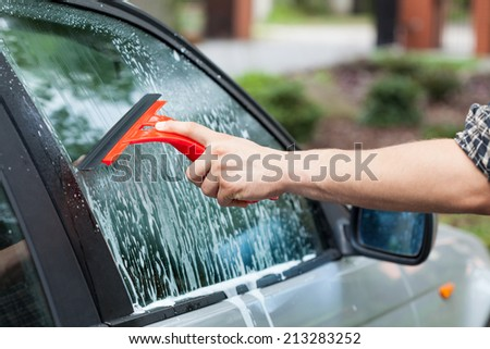 Horizontal view of the cleaning car window - stock photo