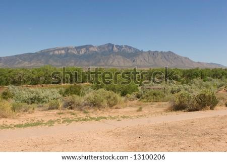 Horizontal view of the Sandia Mountains and the Rio Grande river in Albuquerque, New Mexico - stock photo