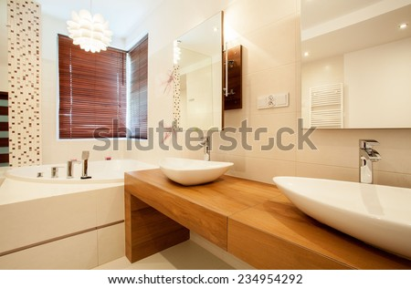 Horizontal view of two sinks in bathroom