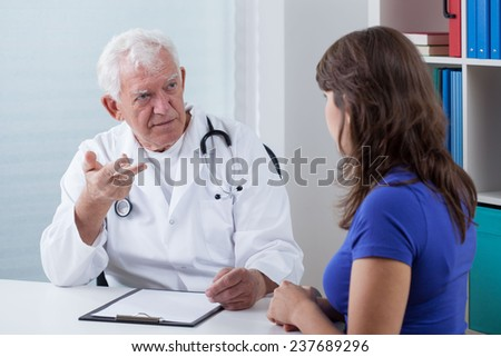 Horizontal view of visit in doctor's office - stock photo