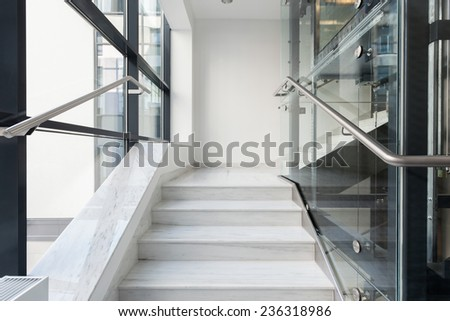 Horizontal view of white stairs in business building - stock photo