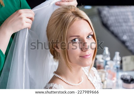 Horizontal view of woman during wedding preparations - stock photo