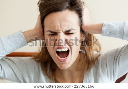 Horizontal view of woman having terrible headache - stock photo