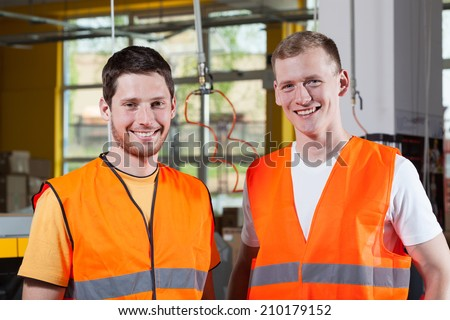 Horizontal view of workers in production factory - stock photo