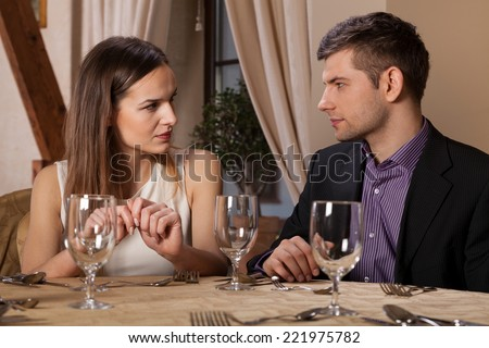 Horizontal view of young couple meeting in restaurant - stock photo