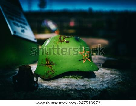 Horizontal vintage Soviet Army helmet battlefield closeup background - stock photo