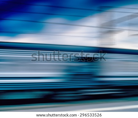 Horizontal vivid blue train motion blur abstraction background backdrop - stock photo