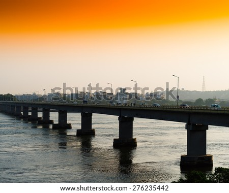 Horizontal vivid orange sunset indian bridge background backdrop