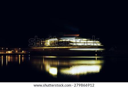 Horizontal vivid rotating ship motion blur night abstraction background backdrop - stock photo