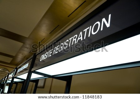 Horizontal wide angle image of a typical conference registration booth. - stock photo