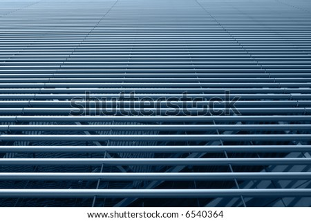 Horizontally placed stainless steel tubes hi-tech facade - stock photo
