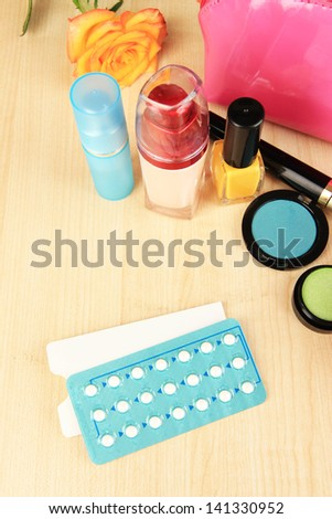 Hormonal pills in women's bedside table close-up - stock photo