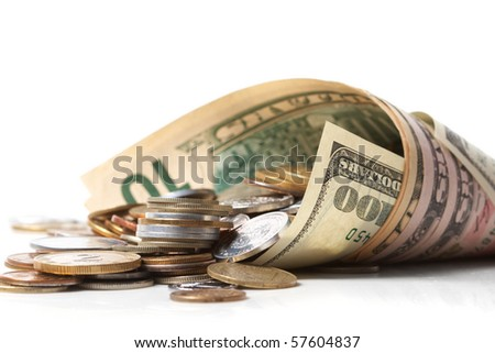 horn from dollar denominations with fine coins - stock photo