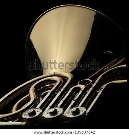 Horn instrument on dark background - stock photo