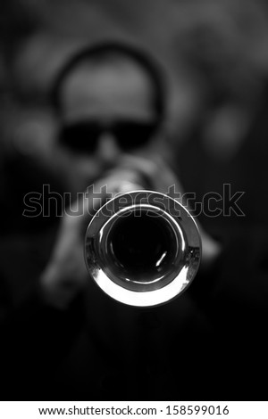 Horn-player (black and white) - stock photo