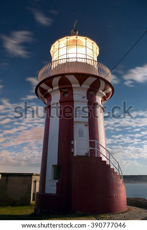 Hornby lighthouse, also known as South Head Lower Light building on a cliff at the entrance to Port Jackson and Sydney Harbour. Located in Watsons Bay. During dusk. Long exposure - stock photo