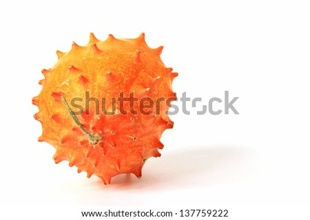 Horned melon (Cucumis metuliferus), isolated against a white background - stock photo