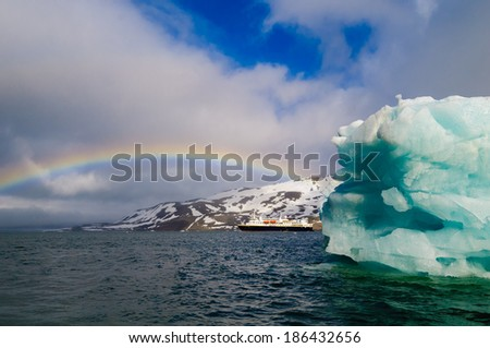 HORNSUND, SVALBARD,NORWAY - JULY 26, 2010:  National Geographic Explorer cruise ship in front of a glacier in the Arctic Ocean. - stock photo