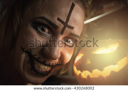 Horrible girl with halloween pumpkin