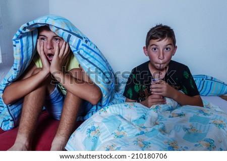 horrified kids watching tv - stock photo