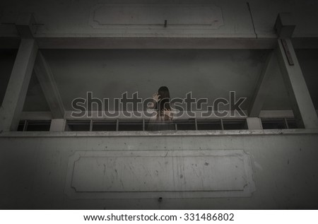 Horror movie scene with a lonely figure on the hall,Horror Scene of a Scary Woman - stock photo