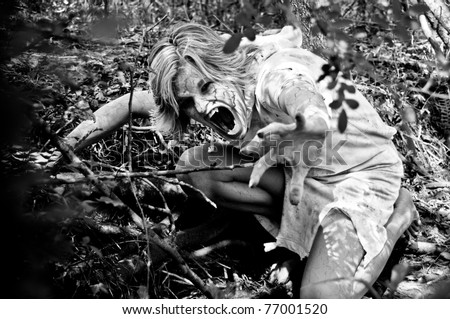 Horror Scene of a Possessed Woman Hiding and Screaming in the Woods - stock photo