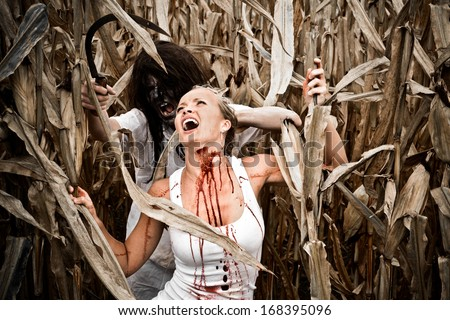 Horror Scene of a Pretty Blonde Woman Being Attacked in a Corn Field  - stock photo