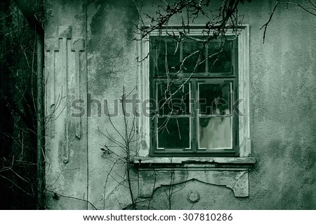 Horror scene of a scary woman. Ghost at the grunge window.