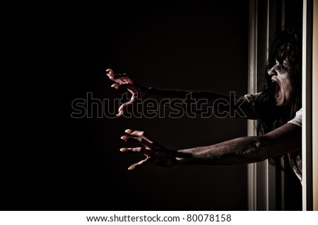 Horror Scene of a Woman Possessed Grabbing out of Doorway - stock photo