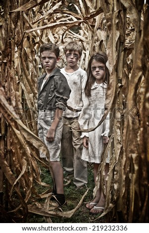 Horror Scene of three children in a Corn Field - stock photo