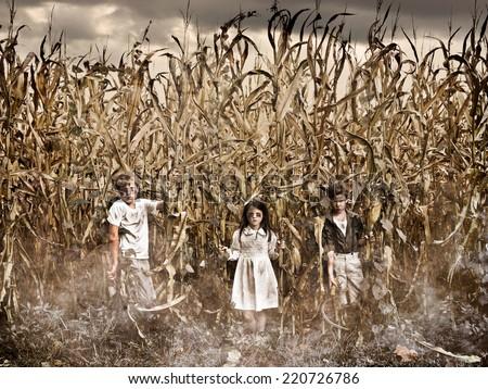 Horror Scene of three children in a Corn Field  - stock photo