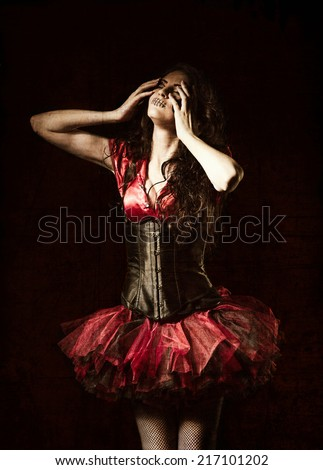 Horror shot: the strange girl with mouth sewn shut among the dark. Grunge texture effect - stock photo