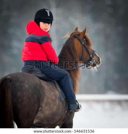 Horse and Jockey - Little boy and  pony. - stock photo