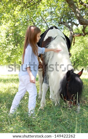 horse and lovely girl - stock photo