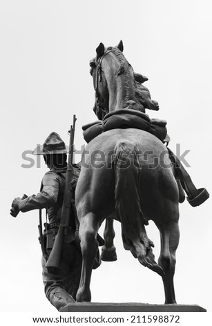 Horse and men monument on white background