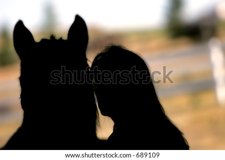 Horse and woman silhouette - represents love and care for an equine companion. - stock photo