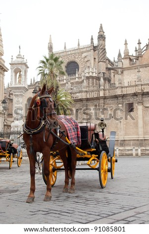 Horse carriage in front of Seville's cathedral, Spain. - stock photo