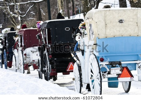 Horse carriages in line at the Central park in New York City - stock photo