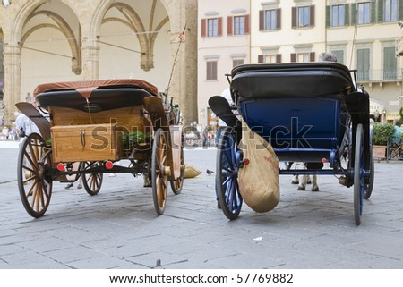 Horse carriages on square in Florence, Italy