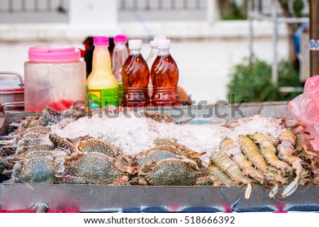 horse crab on street food, prepared or cooked food sold by vendors in a street or other public location for immediate consumption