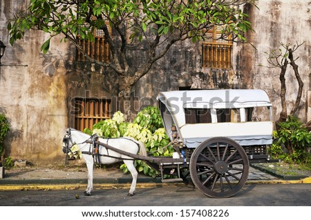 Horse Drawn Calesa waiting for tourists  in Intramuros, a historical part of Manila. - stock photo